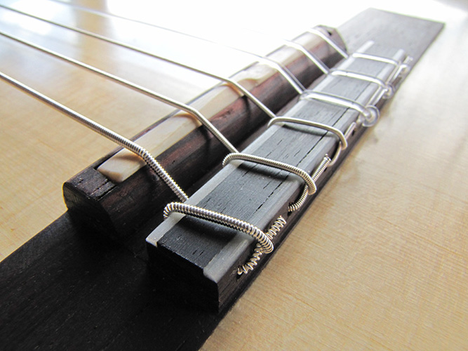 12-hole bridge.  Note the intonated saddle and the break angle of the strings.